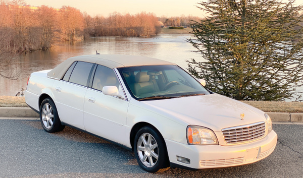 White deville by autosales by autosales