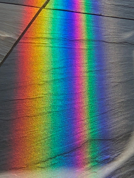 Rainbow on shop floor reflecting from glass doors - NZ Scenery - Graham Reichardt Photography