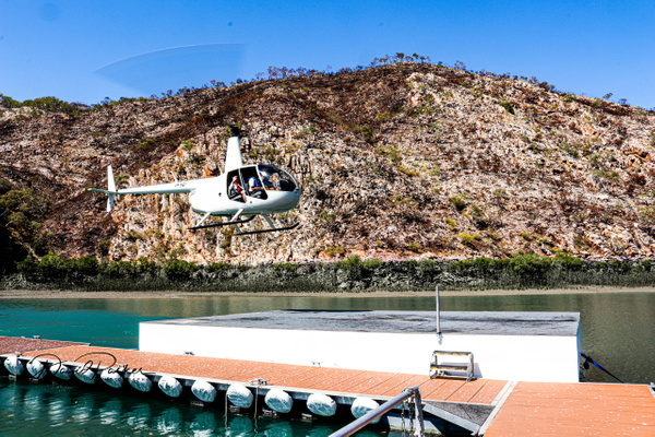Helicopter Landing at the Floating Hotel by...