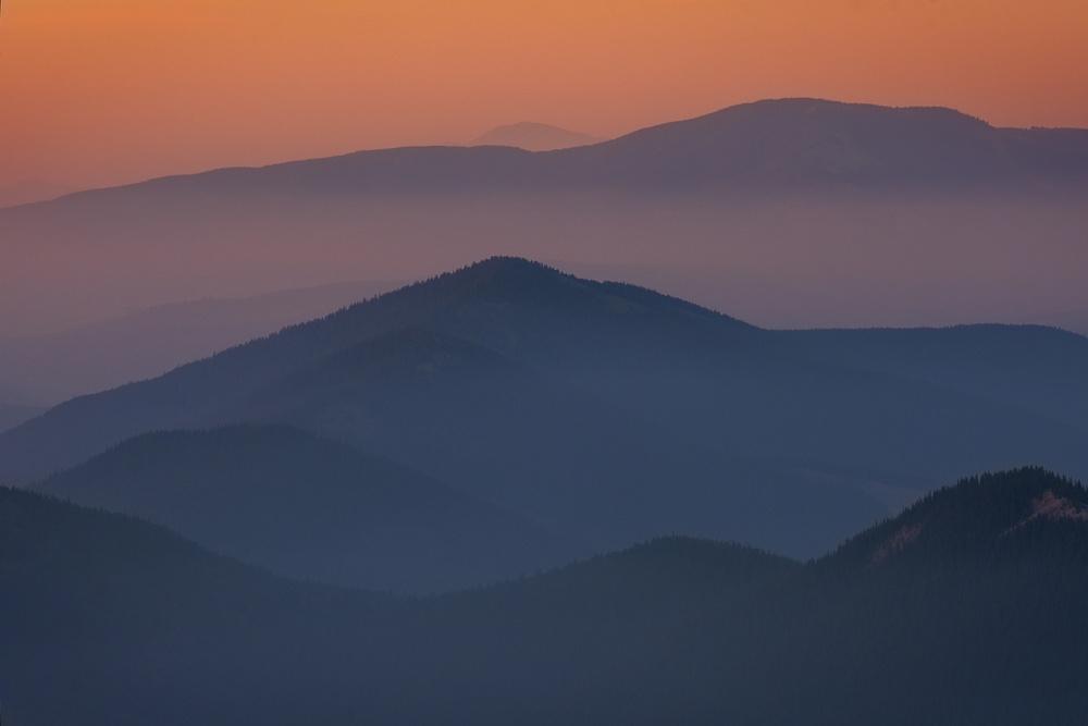 Layers of Mountain Tops under smoky morning, Canadian Rockes, Alberta, Canada