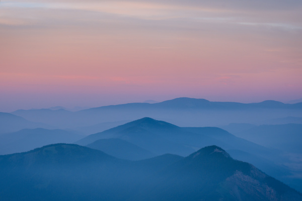 Layers of Mountains Covered of Smoke Forest Fire Sunrise...