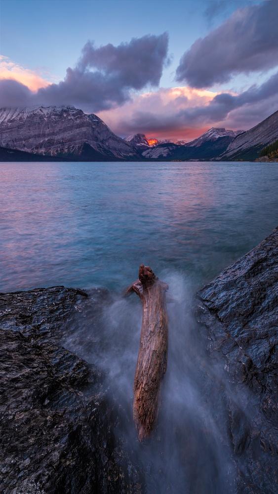 Water Splashing Log in Lake with Sunrise