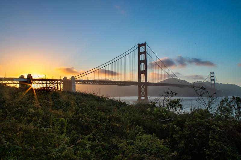 Sunset behind Golden Gate Bridge. Sun over Fort Point.
