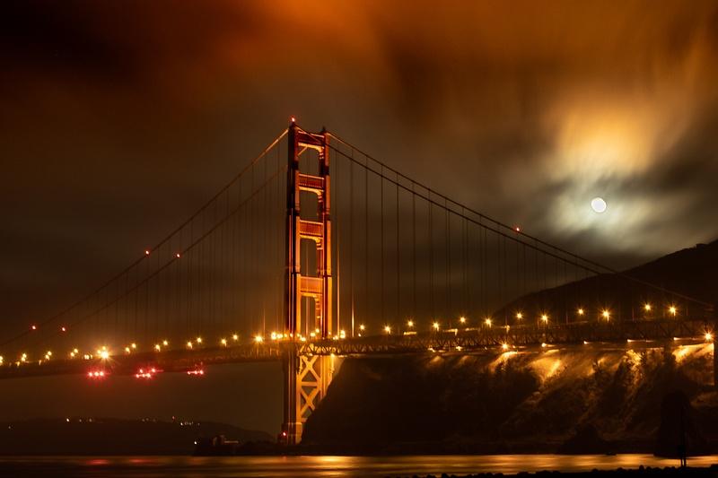 Golden Gate Bridge, fog and full moon 2. Moon setting at 4am.