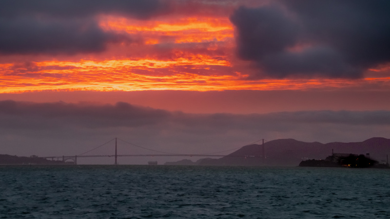 Golden Hour and Golden Gate Bridge with clouds.