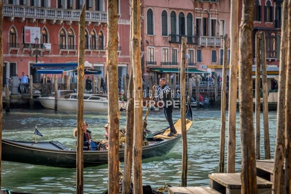 Gondola-between-mooring-poles-Venice-Italy - Photographs of Venice, Italy..