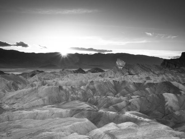 Sunstar at Zabriskie Point by Bruce Crair